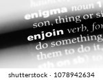 Small photo of enjoin word in a dictionary. enjoin concept