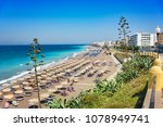 aegean beach with sunshades in... | Shutterstock . vector #1078949741