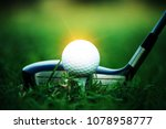 Small photo of golf club and golf ball close up in grass field with sunset. Golf ball close up in golf coures at Thailand