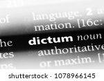 Small photo of dictum word in a dictionary. dictum concept