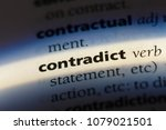 Small photo of contradict word in a dictionary. contradict concept