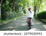 little girl riding a bicycle | Shutterstock . vector #1079030951