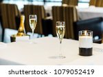 champagne glasses on table | Shutterstock . vector #1079052419