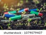 used alkaline batteries lie in...   Shutterstock . vector #1079079407