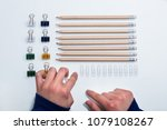 elevated view of a human hand... | Shutterstock . vector #1079108267