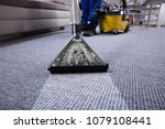 janitor's hand cleaning carpet... | Shutterstock . vector #1079108441