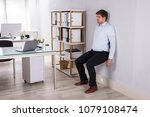 young businessman leaning on... | Shutterstock . vector #1079108474