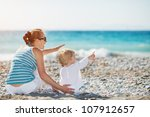 Mother And Baby On Beach...