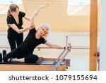 pilates lesson on reformer ... | Shutterstock . vector #1079155694