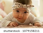 beautiful baby girl with a... | Shutterstock . vector #1079158211