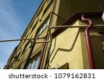 shadows of red pipes on a... | Shutterstock . vector #1079162831