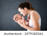 young mother  kissing and...   Shutterstock . vector #1079183261