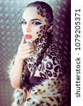 young sexy woman with leopard... | Shutterstock . vector #1079205371