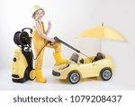 happy child in yellow overalls... | Shutterstock . vector #1079208437
