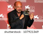 Small photo of VENICE, ITALY - SEPTEMBER 10: Robbie Ryan holds the Osella prize he received for 'Wuthering Heights' during the 68th Venice Film Festival on September 10, 2011 in Venice, Italy