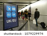 Small photo of London, UK - April 15, 2018: Air travelers proceed along the UK/EU arrivals lane to passport control at Heathrow airport. The immigration status of EU citizens remains unclear following the Brexit.