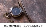 old pocket watch on wooden... | Shutterstock . vector #1079233694