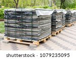 row of stacks of gray pavement... | Shutterstock . vector #1079235095