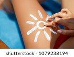 closeup  female  leg with sun...   Shutterstock . vector #1079238194