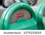green parking meter with car in ... | Shutterstock . vector #1079253035