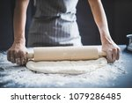 making dough by female hands at ... | Shutterstock . vector #1079286485