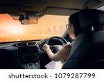 woman driving car on urban... | Shutterstock . vector #1079287799