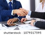 business people shaking hands ... | Shutterstock . vector #1079317595