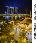Small photo of SINGAPORE CITY, SINGAPORE - APRIL 22, 2018: Spectra Light and Water Show Marina Bay Sand Casino Hotel Downtown Singapore on APRIL 22, 2018