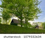 houses and green hedge in... | Shutterstock . vector #1079332634