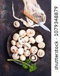 raw mushrooms  raw champignons  ... | Shutterstock . vector #1079348879