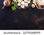 raw mushrooms  raw champignons  ... | Shutterstock . vector #1079348999