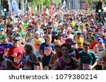 Small photo of London, England, April 22nd 2018: Massed runners on the Isle of Dogs running in the 2018 London Marathon