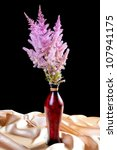 bouquet astilbe with a fabric... | Shutterstock . vector #107941175
