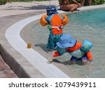 kids play in a pool at tropical ... | Shutterstock . vector #1079439911
