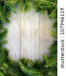 Christmas Fir Tree On A Wooden...