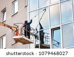 washing the glass facade at a... | Shutterstock . vector #1079468027