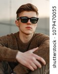 handsome young man hipster with ... | Shutterstock . vector #1079470055