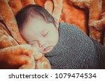 close up newborn baby sleeping... | Shutterstock . vector #1079474534