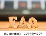 the word 'faq' made of wooden...   Shutterstock . vector #1079494307