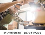 low angle portrait of handsome... | Shutterstock . vector #1079549291