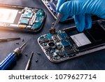 the asian technician repairing... | Shutterstock . vector #1079627714