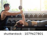 fitness man and asian woman... | Shutterstock . vector #1079627801