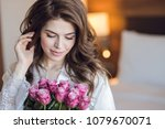 beautiful bride with a bouquet... | Shutterstock . vector #1079670071