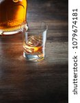 view of glass of  whiskey and a ... | Shutterstock . vector #1079674181