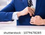 businessman receiving his...   Shutterstock . vector #1079678285