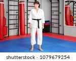 female karate instructor in dojo | Shutterstock . vector #1079679254