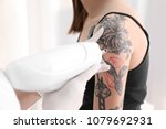 cosmetologist with patient and... | Shutterstock . vector #1079692931