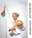 Small photo of Ibri, Oman, 28th April 2018: men dancing and singing omani traditional way