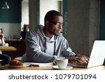 serious millennial african... | Shutterstock . vector #1079701094