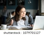 smiling girl looking at laptop... | Shutterstock . vector #1079701127